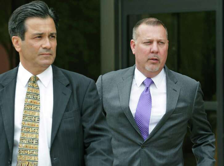 Stan Bates, right, walks with his lawyer Karl A. Basile from the federal courthouse on May 17. Basile on Wednesday filed a motion to withdraw as Bates' lawyer because of a conflict of interest. State Sen. Carlos Uresti, a co-defendant in the case, opposes Basile's withdrawal from the case.