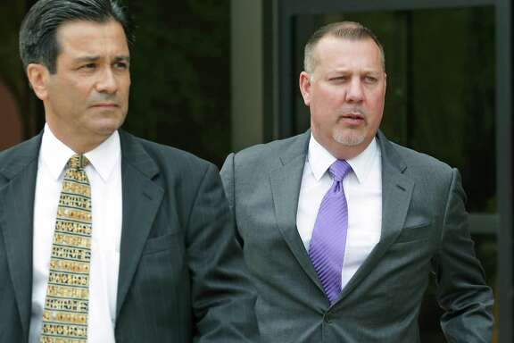 Stan Bates, right, leaves the John H. Wood Jr. Federal Courthouse in May following his arrest in a criminal fraud case involving a now-defunct frac-sand company called FourWinds Logistics. With Bates is his court-appointed lawyer, Karl A. Basile.