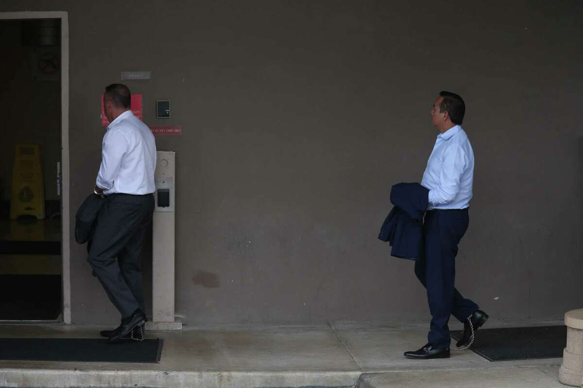 Stan Bates, left, is followed by now-ex state Sen. Carlos Uresti as they are led by law enforcement into San Antonio federal court after they were arrested by the FBI on May 17, 2017. A jury later convicted Uresti and he was sentenced to 12 years in prison for his involvement in FourWinds Logistics. Bates, who served as the company's CEO and majority owner, learns his fate today.
