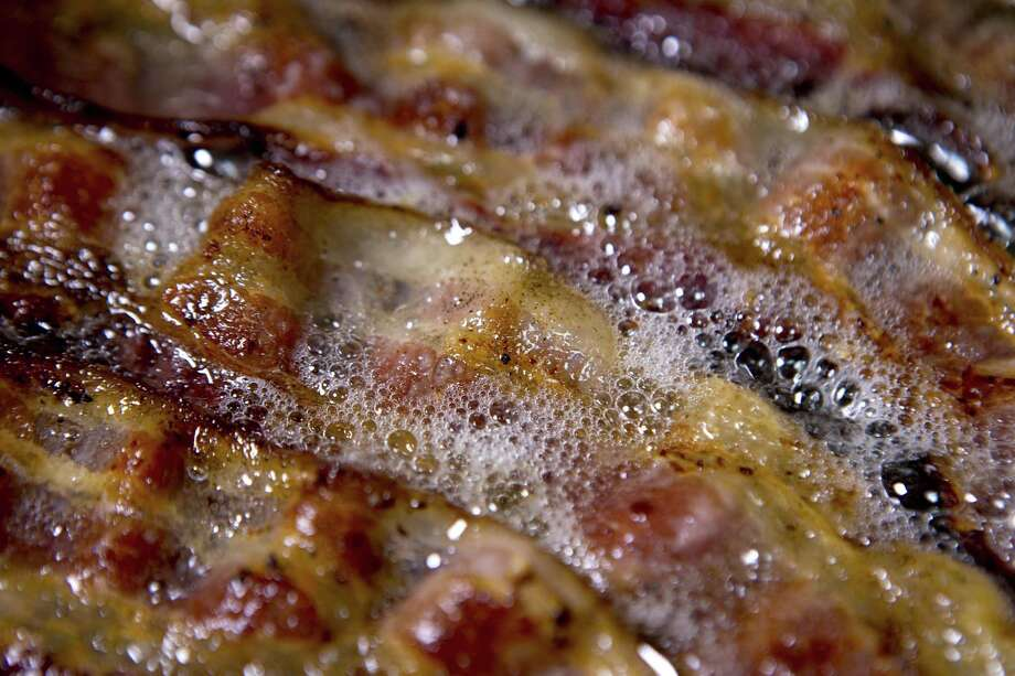 """Bacon-themed food items will be available at """"Bacon Bacon Bacon,"""" an Aug. 12 fundraiser planned at the downtown Freetail Brewery location. Photo: Andrew Harrer /Bloomberg / © 2014 Bloomberg Finance LP"""