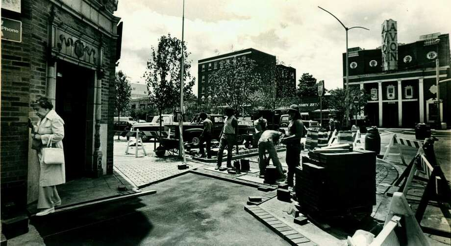 June 14, 1985: Workers upgrade sidewalks on Bedford Street in Stamford where the city hoped improvements would help merchant compete with the Stamford Town Center Shopping Mall. Photo: File Photo, ST / Stamford Advocate File Photo