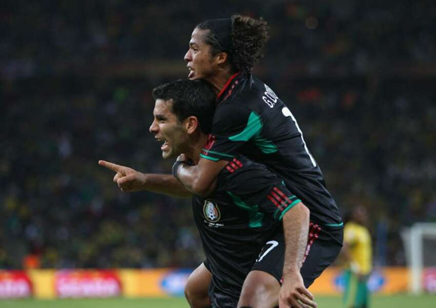 JOHANNESBURG, SOUTH AFRICA - JUNE 11: Giovani Dos Santos of Mexico celebrates with Rafael Marquez of Mexico after he scored the second goal to equalise during the 2010 FIFA World Cup South Africa Group A match between South Africa and Mexico at Soccer City Stadium on June 11, 2010 in Johannesburg, South Africa. (Photo by Michael Steele/Getty Images) *** Local Caption *** Rafael Marquez;Giovani Dos Santos