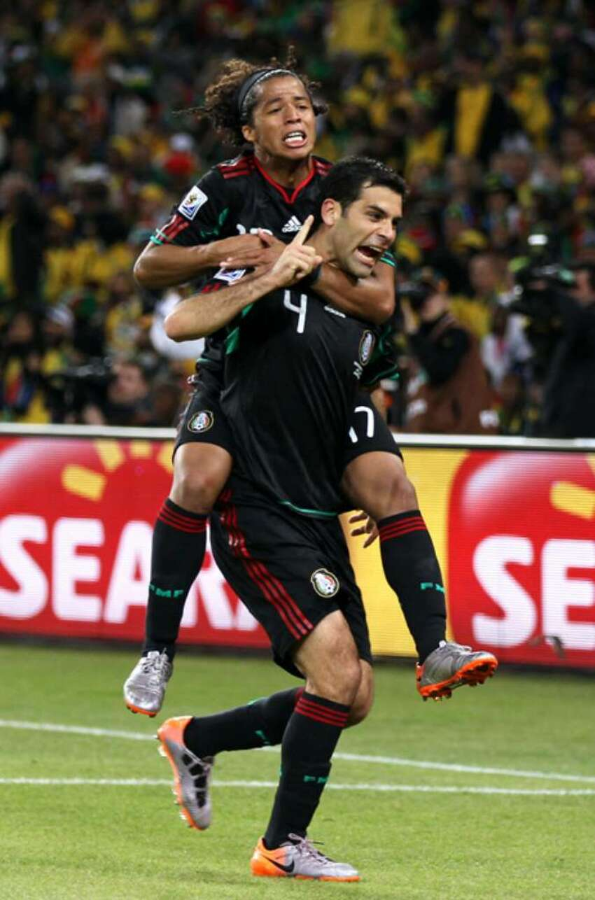JOHANNESBURG, SOUTH AFRICA - JUNE 11: Giovani Dos Santos celebrates with Rafael Marquez of Mexico after he scored the second goal to equalise during the 2010 FIFA World Cup South Africa Group A match between South Africa and Mexico at Soccer City Stadium on June 11, 2010 in Johannesburg, South Africa. (Photo by Phil Cole/Getty Images) *** Local Caption *** Rafael Marquez;Giovani Dos Santos