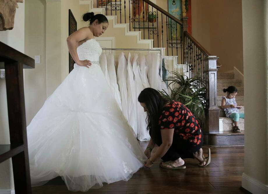 Monica Narvaez Checks The Bottom Of Marcela Trejos Wedding Dress During A Fitting On Friday In