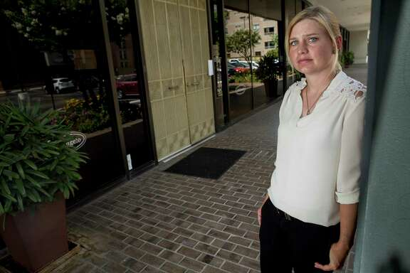 Monica Carroll poses for a photo outside Alfred Angelo, a bridal shop, that closed last week, on Thursday, July 20, 2017, in Houston. Carroll, whose wedding is set for November 18, purchased her dress in March from the store, but it is now locked inside and she is unable to retrieve it. ( Brett Coomer / Houston Chronicle )
