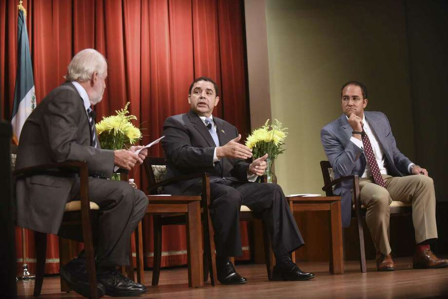U.S. Reps. Henry Cuellar, D-Laredo, middle, and Will Hurd, R-Helotes, right, discuss NAFTA last year, saying they already had bids to bring a revised agreement back to its hometown. Photo: Billy Calzada /Staff File Photo / San Antonio Express-News
