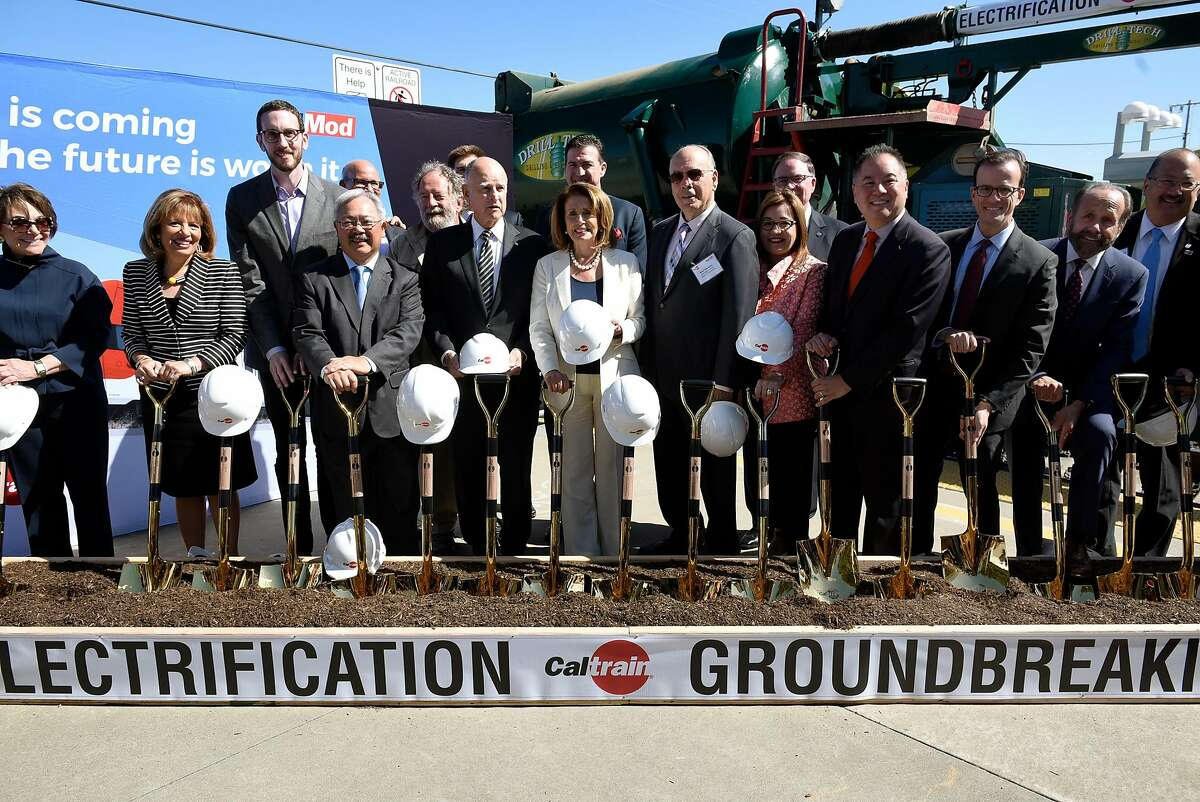 The group of dignitaries poses for a picture during a groundbreaking ceremony and event for Caltrain's electrification and modernization project, at the Caltrain Station in Millbrae, CA, on Friday July 21, 2017.