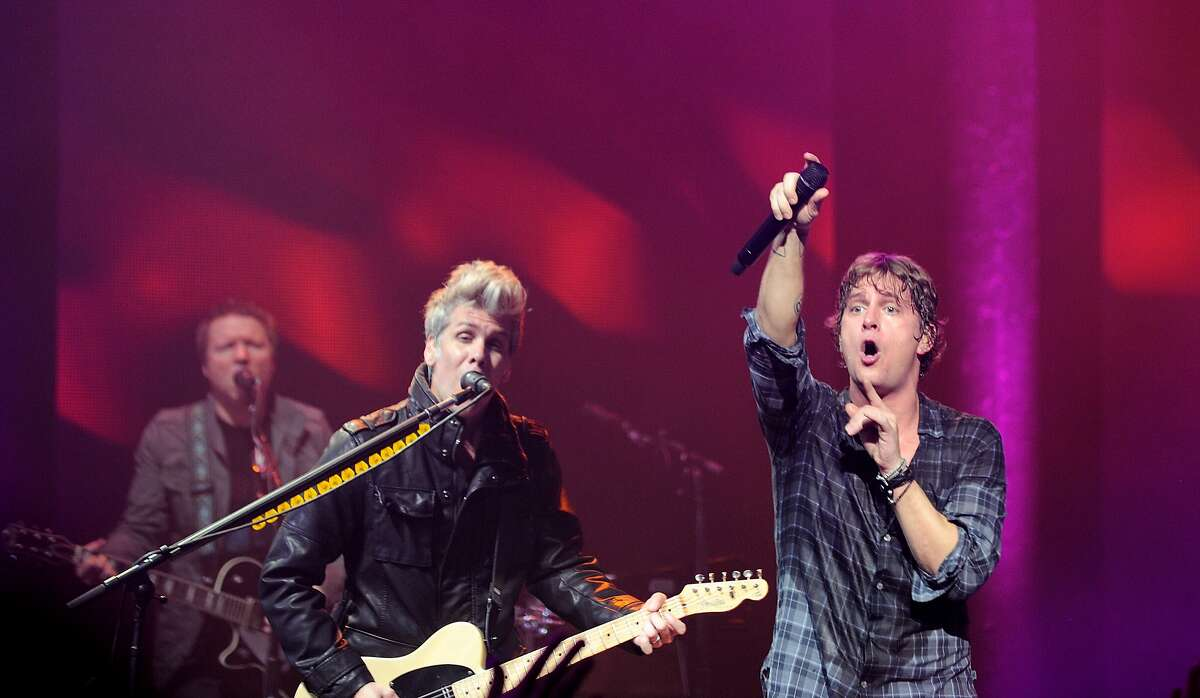 Kyle Cook and Rob Thomas of Matchbox Twenty perform on stage at The Roundhouse on September 19, 2012 in London, United Kingdom. (Photo by Gus Stewart/Redferns via Getty Images)