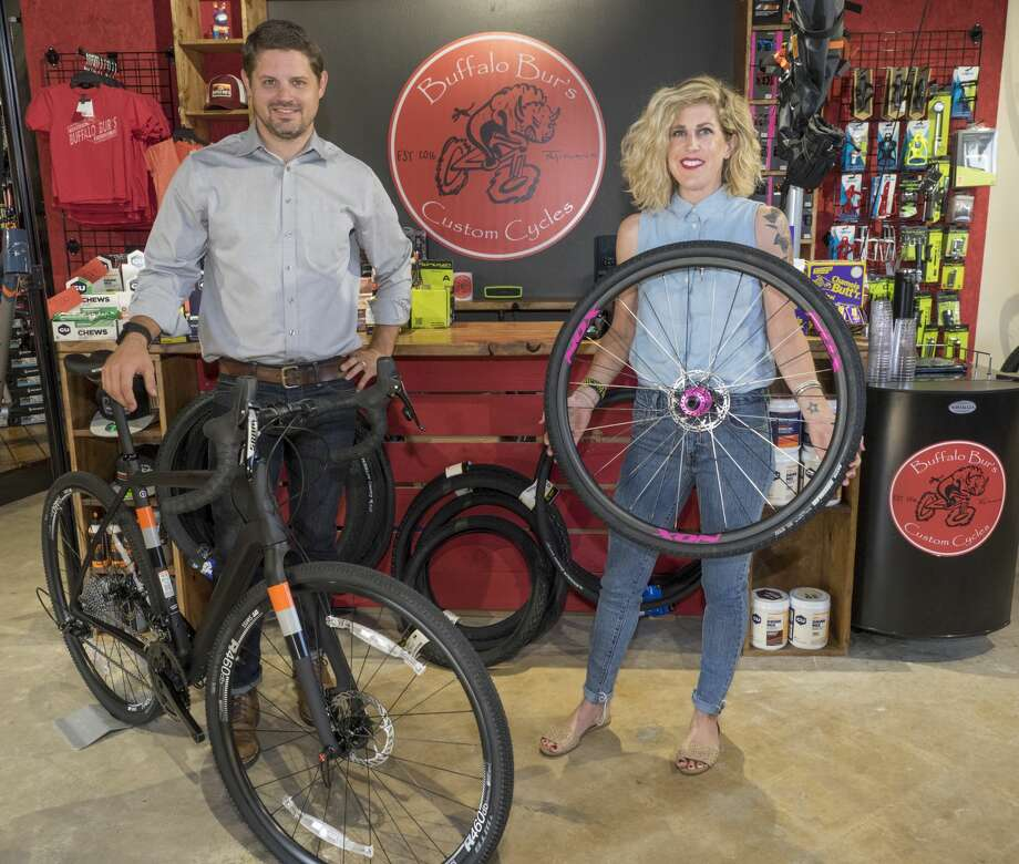 Jeff and Stephanie Ledford show off the custom bicycles they sell at Buffalo Bur's. The shop is named for the plant whose prickles attach to bikes of off-road cyclists Photo: Tim Fischer/Midland Reporter-Telegram