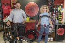 Jeff and Stephanie Ledford show off the custom bicycles they sell at Buffalo Bur's. The shop is named for the plant whose prickles attach to bikes of off-road cyclists