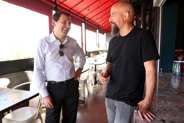 San Francisco Football Club owner Nick Swinmurn, right, talks with team president Jordan Gardner.