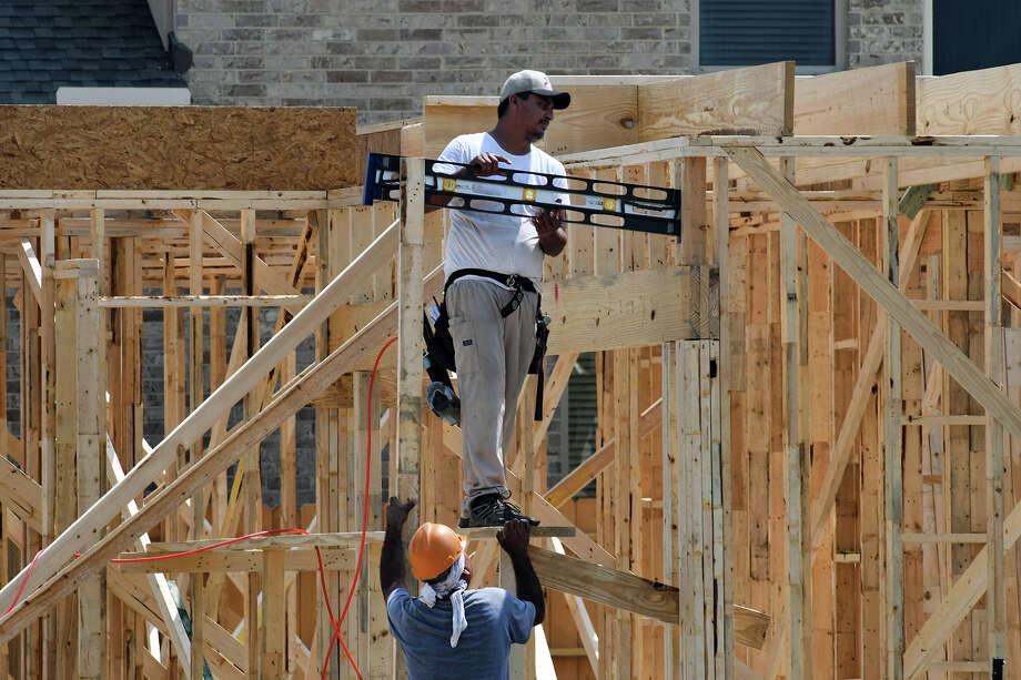 Home construction continues to boom in the Cypress Creek Lakes subdivision off of Fry Road in Cypress. (Photo by Jerry Baker/Freelance) Photo: Jerry Baker, Freelance / Freelance