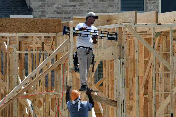 Home construction continues to boom in the Cypress Creek Lakes subdivision off of Fry Road in Cypress. (Photo by Jerry Baker/Freelance)