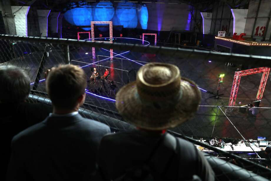 A group watches as 16 contestants compete in San Francisco's Aerial Sports League's drone drag race in the Palace of Fine Arts Theater. Photo: Scott Strazzante, The Chronicle