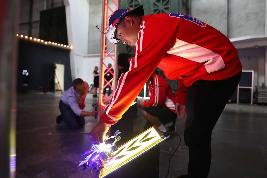 "Justin Baltazar of Santa Clara places his drone at the starting line for the drag race at the Palace of Fine Arts Theater in San Francisco. ""This is going to be the next version of NASCAR,"" said Baltazar, 28. Photo: Scott Strazzante, The Chronicle"