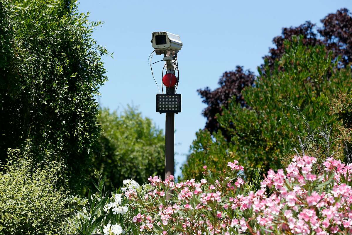 A surveillance camera records vehicles entering and leaving the Scott Creek Terrace neighborhood in Fremont, Calif. on Thursday, July 20, 2017. Residents of the sub-division in the southernmost area of the city were among the first to install the cameras. Consistently rated as one of the safest cities in the nation, Fremont has not had any homicides reported since 2015.