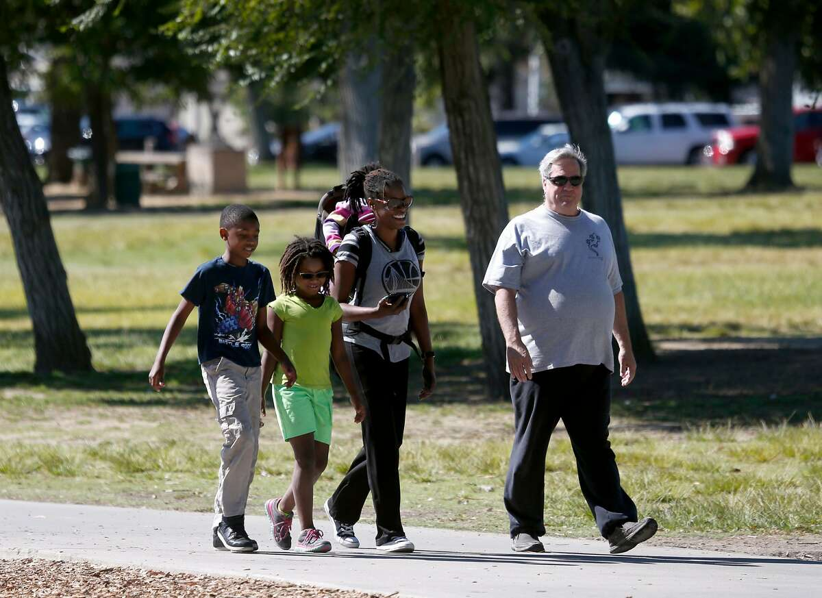 Tamika Banks and her children Isiah Carroll, Hannah Carroll and Gabriella Carroll, walk in Central Park with their friend Cory Norton (right) in Fremont, Calif. on Thursday, July 20, 2017. Consistently rated as one of the safest cities in the nation, Fremont has not had any homicides reported since 2015.