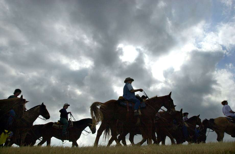 Members if The Old Chisholm Trail Drivers Association ride 15 miles Jan. 30, 2002, from La Vernia to China Grove on the fifth day of their 100-mile journey, which started in Cuero and ended in San Antonio for the 53rd San Antonio Livestock Show and Rodeo. Photo: Express-News File Photo / SAN ANTONIO EXPRESS-NEWS