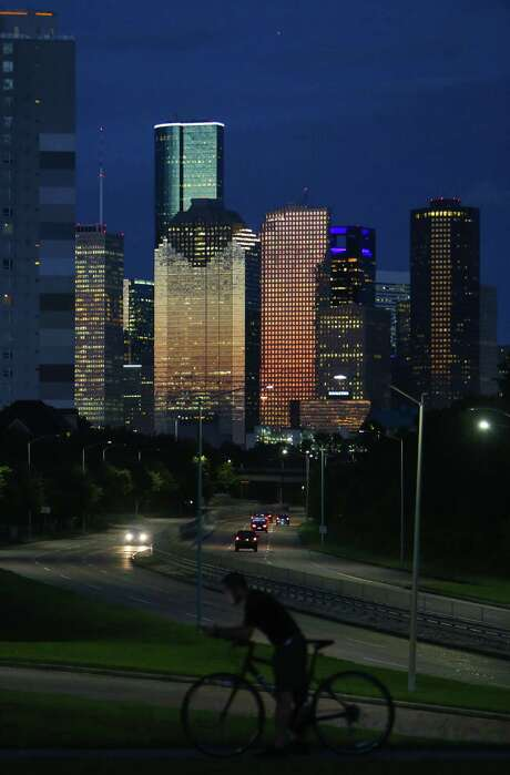 The downtown Houston skyline shortly after sunset over Memorial Drive.  (Mark Mulligan / Houston Chronicle) Photo: Mark Mulligan, Staff Photographer / 2017 Mark Mulligan / Houston Chronicle