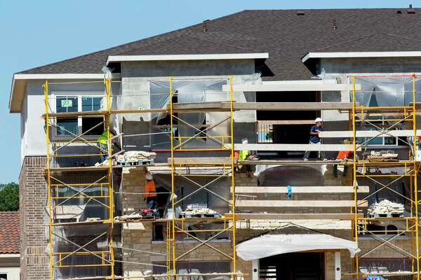 Construction continues in May at an apartment complex along Loop 336 in Conroe. A new study shows that almost two of every five U.S. households is headed by a renter.