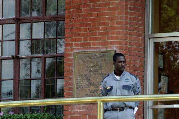 A corrections officer keeps watch outside the Texas Department of Criminal Justice Huntsville Unit in Huntsville. (AP file photo)