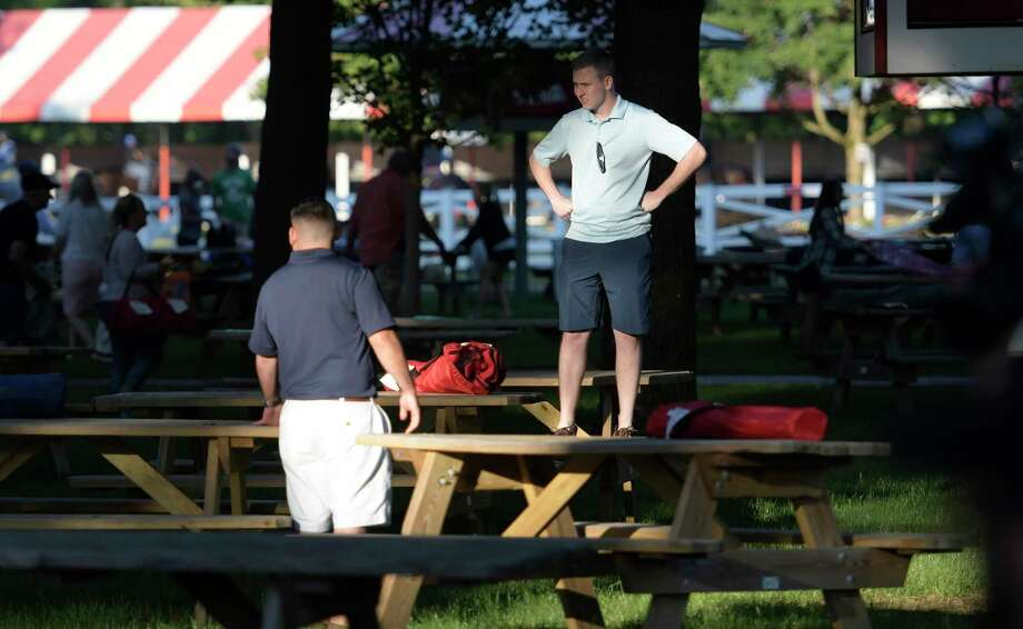 Kevin Watson of Watervliet stakes his claim on a picnic table in the back yard of the Saratoga Race Course on opening day Friday July 21, 2017 in Springs, N.Y. (Skip Dickstein/Times Union) Photo: SKIP DICKSTEIN / 40041030A