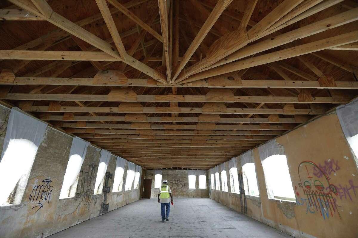 Construction superintendent Jesse Escoto walks through the top floor of the Hot Wells resort.