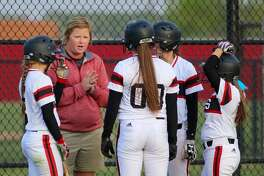 Anna Whiddon, shown here coaching her old team, Mineral Wells, has been hired as the new softball coach at New Caney High School.