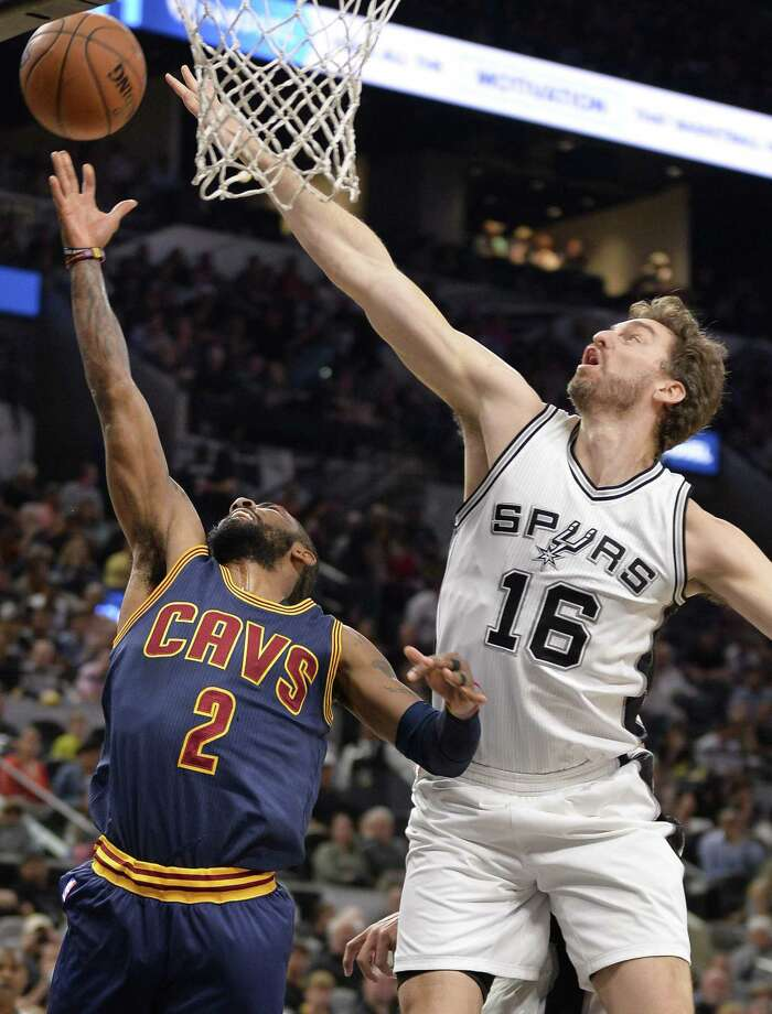 Cleveland Cavaliers guard Kyrie Irving (2) shoots against Spurs center Pau Gasol during the first half on March 27, 2017, in San Antonio. Photo: Darren Abate /Associated Press / FR115 AP