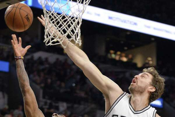 Cleveland Cavaliers guard Kyrie Irving (2) shoots against Spurs center Pau Gasol during the first half on March 27, 2017, in San Antonio.
