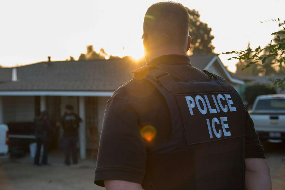 FILE — Immigration and Customs Enforcement agents after a predawn raid that failed to capture their target, in Riverside, Calif., June 22, 2017. Every day around the U.S., from before sunrise until late into the night, undocumented immigrants are being picked up by ICE officers, the front-line soldiers in President Donald Trump's crackdown on illegal immigration. (Melissa Lyttle/The New York Times) Photo: MELISSA LYTTLE, NYT