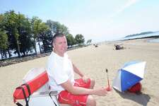 Long-time Greenwich lifeguard Mike Dorrian at his Island Beach post in Greenwich, Conn., Thursday, July 20, 2017. When the summer ends, Dorrian returns to his regular gig as a history teacher at Paramus Catholic High School in New Jersey.