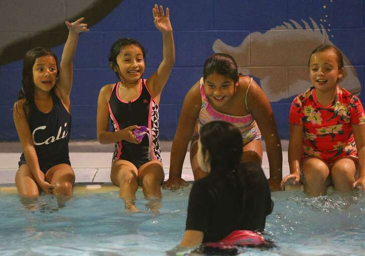 Instructor Nicholette Solis (facing away) teaches children about swimming Tuesday July 18, 2017 at the Calderon Branch of the Boys and Girls Clubs of San Antonio during the ZAC Camp held by the ZAC Foundation in partnership with the Boys & Girls Clubs of San Antonio. The ZAC Foundation is a Connecticut-based water safety advocacy and education foundation that teaches children through hands-on activities the importance of water safety through swimming classes. Karen and Brian Cohn founded the ZAC Foundation in 2008 after the loss of their son Zachary when he drowned as a result of being entrapped in the suction of a swimming pool drain.