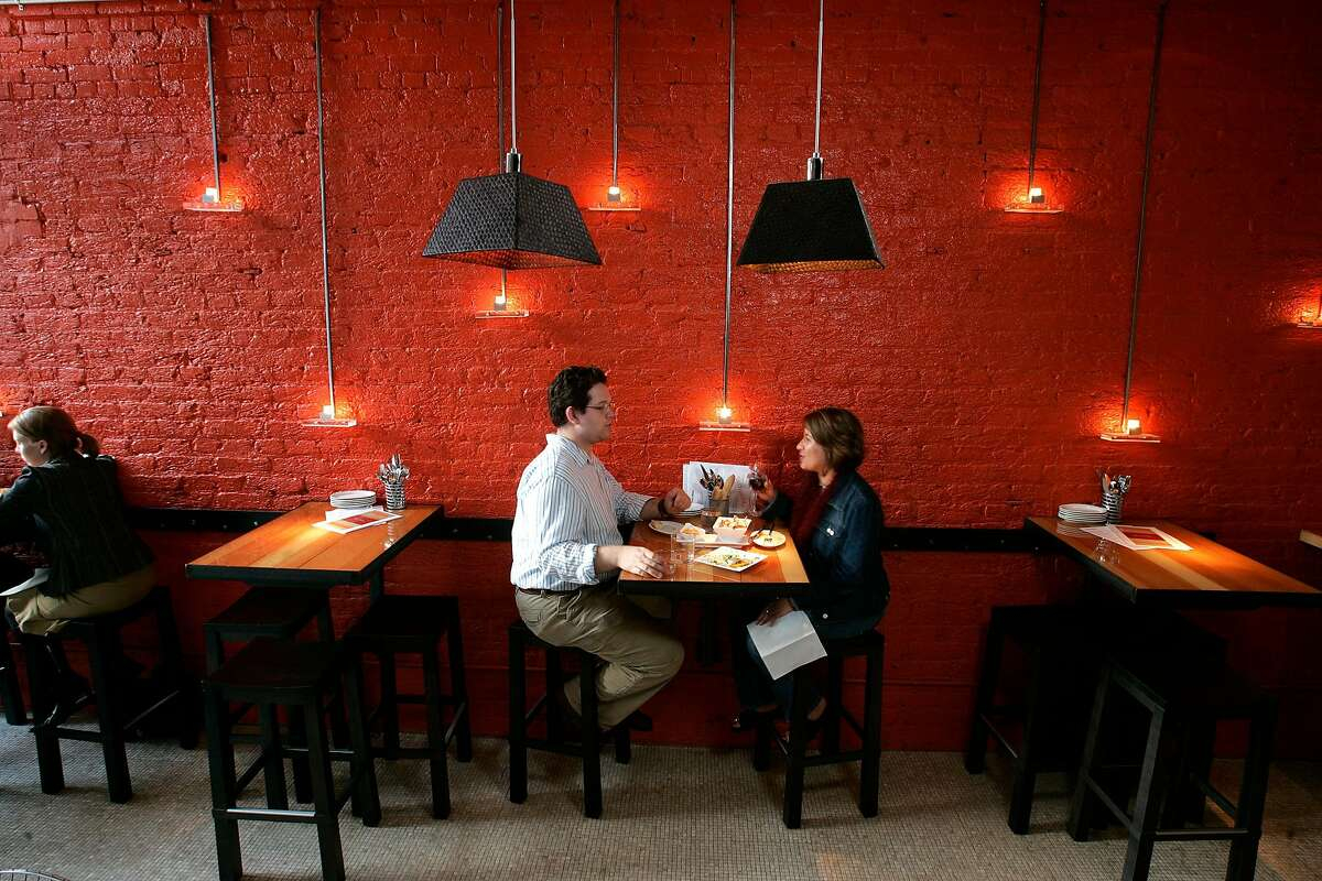 """d.17bocadillos085_mac.jpg Christopher Gomez and Tammy Bastian enjoy a couple of glasses of wine a few dishes at the newly opened restaurant. """"Bocadillos"""" near the corner of Montgomery and Washington Streets in SF, features Spanish tapas. 9/28/04 Michael Macor / San Francisco Chronicle Ran on: 02-22-2007 Diners enjoy a casual dinner with wine at the small-plates restaurant Bocadillos in San Francisco."""