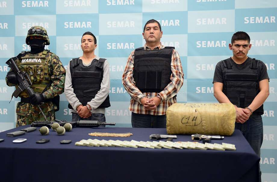 "Ivan Velazquez Caballero, aka ""Z 50"" or ""El Taliban"" (2nd-R),  senior leader in the Zetas drug cartel and member of the Gulf cartel, is presented to the press at the Mexican Navy headquarters in Mexico City, on September 27, 2012.  Velazquez Caballero was on a list of Mexico's most wanted drug traffickers, with an offer of some $2.3 million for information leading to his capture. AFP PHOTO/Alfredo EstrellaALFREDO ESTRELLA/AFP/GettyImages Photo: ALFREDO ESTRELLA, AFP/Getty Images"