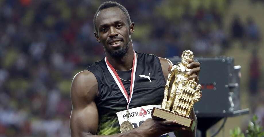 Jamaica's Usain Bolt poses with a trophy during the podium ceremony at the IAAF Diamond League Athletics meeting at the Louis II Stadium in Monaco, Friday, July 21, 2017. In the last Diamond League race of his glittering career, Usain Bolt has held on to win the 100 meters at the Herculis track meet in Monaco. (AP Photo/Claude Paris) Photo: Claude Paris/Associated Press