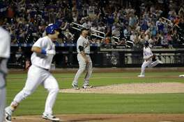 Oakland Athletics relief pitcher Frankie Montas, center, reacts as New York Mets' Michael Conforto, left, and Matt Reynolds, right, runs the bases after Conforto hit a two-run home run during the seventh inning of an interleague baseball game Friday, July 21, 2017, in New York. (AP Photo/Frank Franklin II)