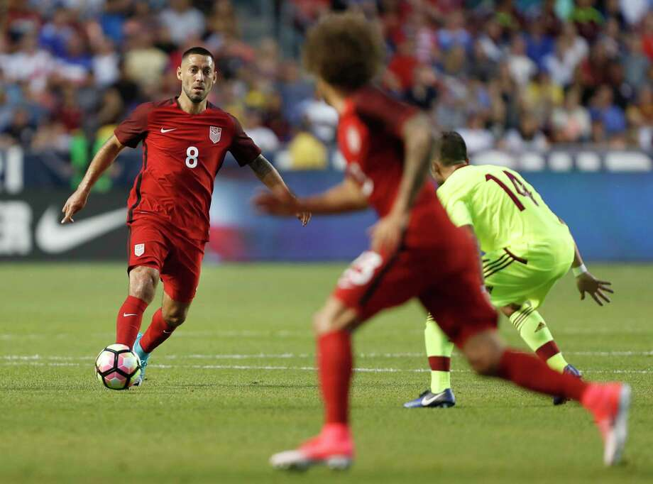 SANDY, UT - JUNE 3: United States forward Clint Dempsey #8 looks to pass the ball to defender Fabian Johnson #23 as Venezuela's midfielder JA°nior Moreno #14 defends during the first half of an international friendly soccer game on June 3, 2017 at Rio Tinto Stadium in Sandy, Utah. (Photo by George Frey/Getty Images) ORG XMIT: 700036947 Photo: George Frey / 2017 Getty Images