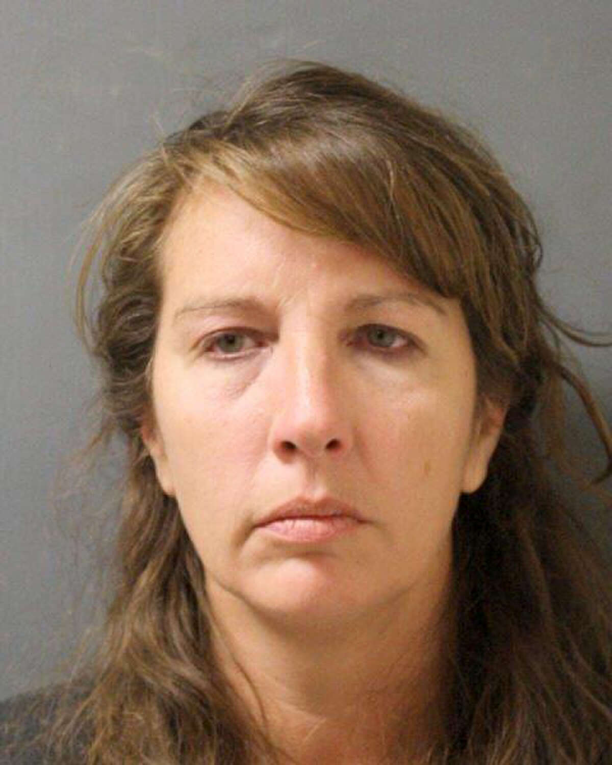 This undated photo provided by the Harris County Sheriff's Office shows the booking photo of Houston-area sheriff's deputy Chauna Thompson. The Harris County sheriff's office said Friday, June 9, 2017, that Thompson and her husband Terry Thompson have posted bail and that they have a court hearing scheduled for Tuesday, after they surrendered to authorities late Thursday after a grand jury that day handed up separate indictments against them. The Thompson's are accused of causing the May 28 death of 24-year-old John Hernandez outside a Houston-area restaurant. (Harris County Sheriff's Office via AP)
