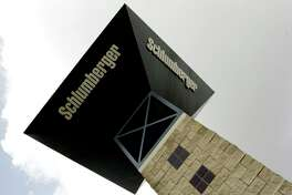 A sign tower reaches toward the sky at the entrance to Schlumberger's Sugar Land campus.
