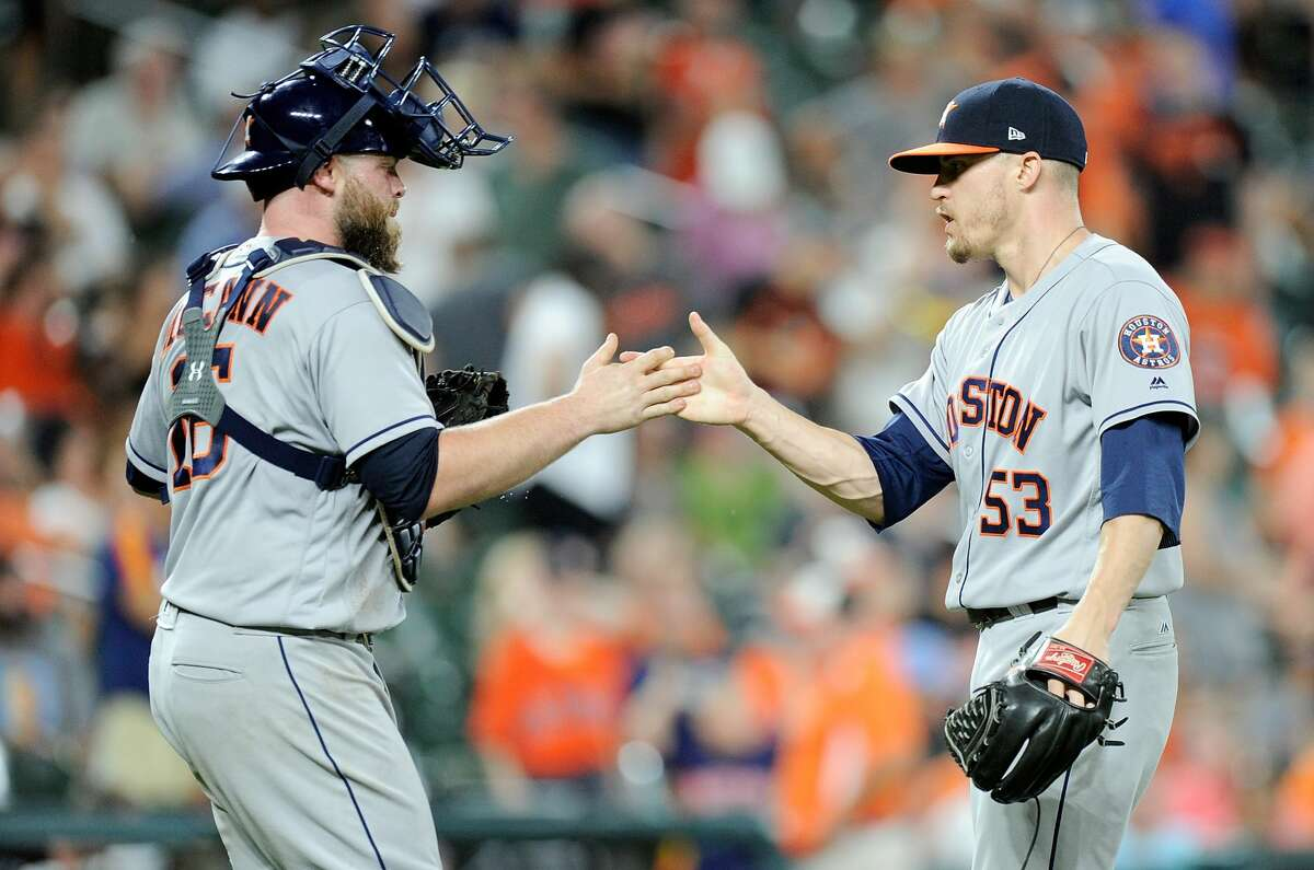 BALTIMORE, MD - JULY 21: Ken Giles #53 of the Houston Astros celebrates with Brian McCann #16 after a 8-7 victory against the Baltimore Orioles at Oriole Park at Camden Yards on July 21, 2017 in Baltimore, Maryland. (Photo by Greg Fiume/Getty Images)