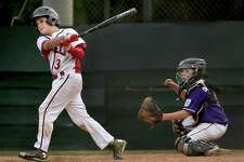 North Branford catcher John Onofrio watches the ball sail over the fence as Fairfield American's Aidan Rivera hits a grandslam in the fifth inning in a 23-9 win in the Section I semifinals, Friday, July 21, 2017, at the Henry Roche Memorial Field at the Orange Little League Complex. (Catherine Avalone – Hearst Connecticut Media)