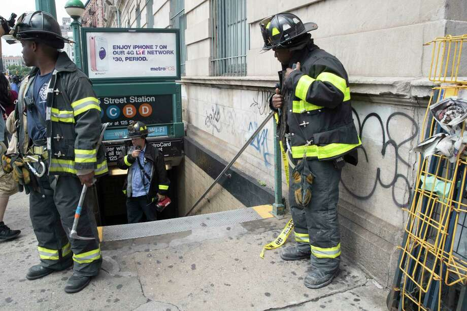 """FILE- In this June 27, 2017 file photo, emergency service personnel work at the scene of a subway derailment in the Harlem neighborhood of New York. Transit in and around New York City has been plagued by a series of derailments, delays and breakdowns, with the latest one coming on Friday, July 21 with the derailment of a """"B"""" line train at Brighton Beach in the Brooklyn borough of New York. (AP Photo/Mary Altaffer, File) ORG XMIT: NYR101 Photo: Mary Altaffer / Copyright 2017 The Associated Press. All rights reserved."""