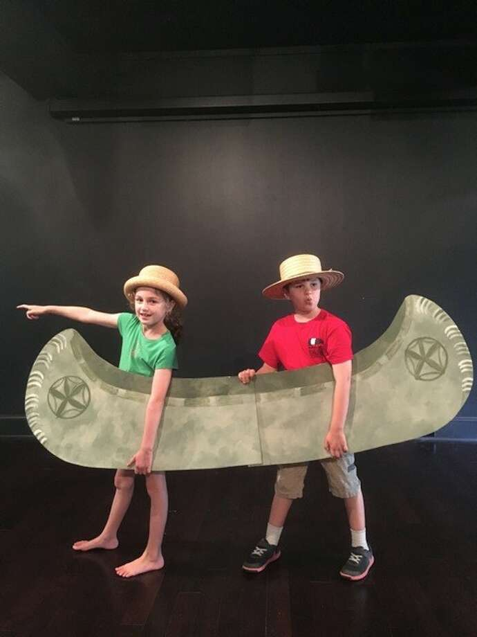 "Siblings Eden (left) and Zach Kopans float a canoe in ""The Golden Phoenix"" at the National Museum of Dance in Saratoga Springs. (Photo courtesy of Will Severin)"