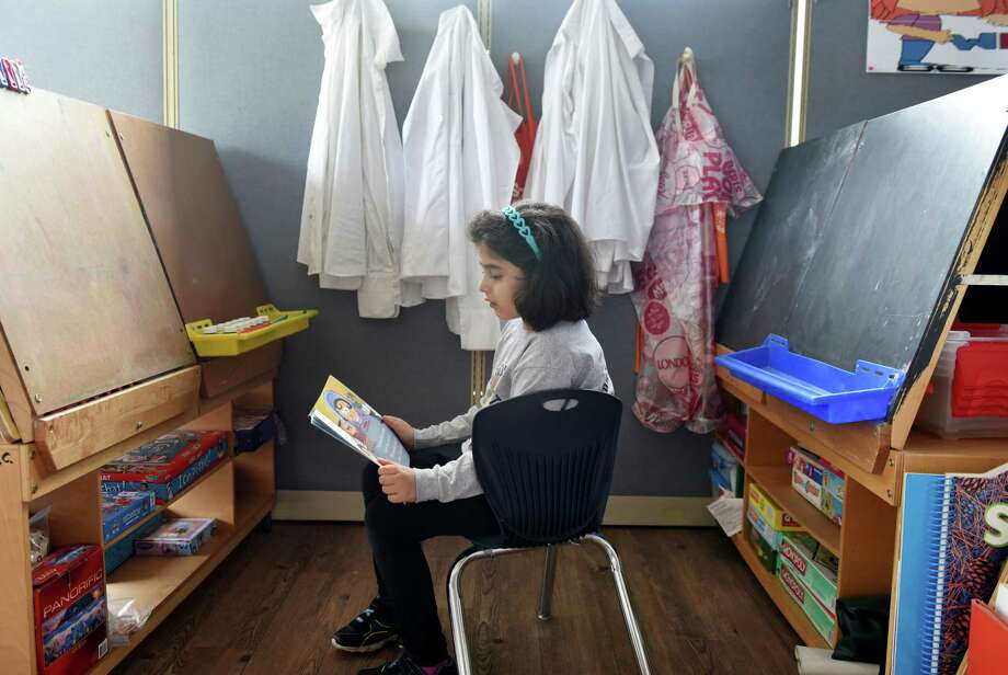 Mariam Hawana, 7, of Schenectady reads aloud by herself at the Bright Hope Center Academy on Friday, July 21, 2017, on Central Ave. in Schenectady, N.Y. (Will Waldron/Times Union) Photo: Will Waldron / 20041103A