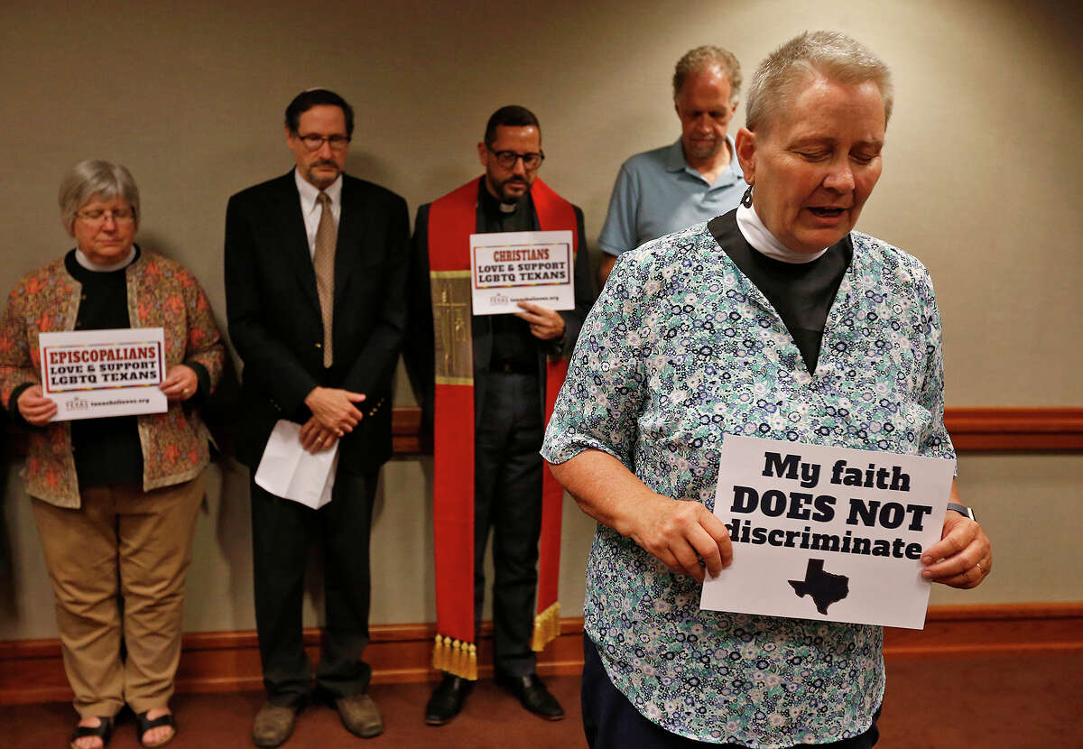 Rev. Mary Wilson, pastor at Church of the Savior in Cedar Park leads a prayer during a blessing and prayer for transgender Texans in Austin on Friday.