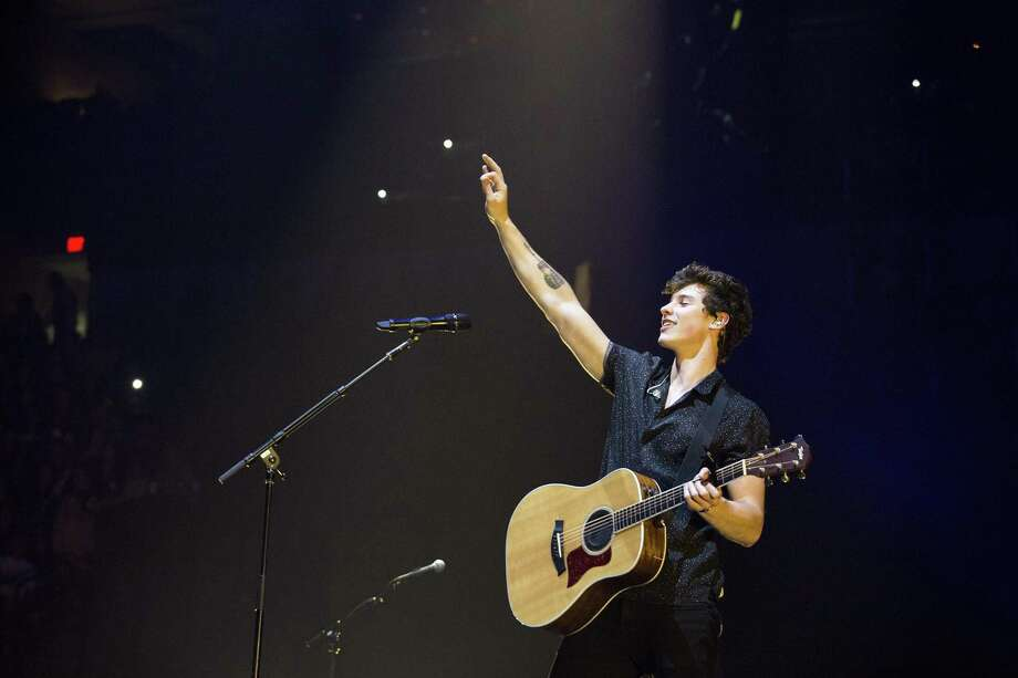 Shawn Mendes performs Friday at the AT&T Center in San Antonio. Mendes and Charlie Puth teamed up for a concer that draw a crowd topping 14,000, making it one of the biggest concerts of the year. Photo: Ray Whitehouse /For The San Antonio Express-News