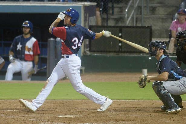 RockHounds' Viosergy Rosa hits a three run double against Corpus Christi July 21, 2017, at Security Bank Ballpark. James Durbin/Reporter-Telegram