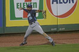 Corpus Christi left fielder Jason Martin retrevies a hit from the RockHounds on July 21, 2017, at Security Bank Ballpark. James Durbin/Reporter-Telegram