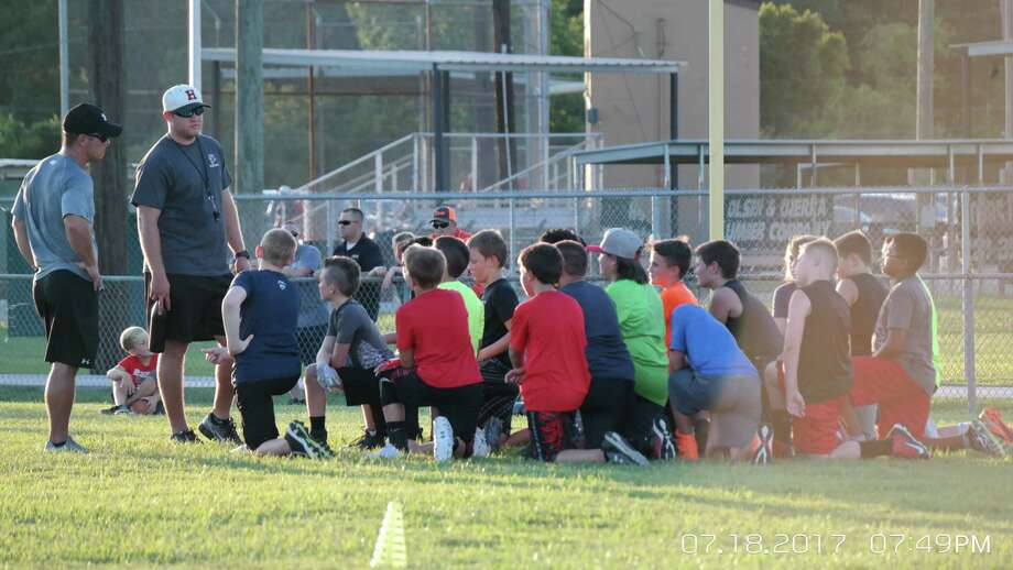 Huffman Youth Athletic Association President Alan McMullen addresses a group of campers at the HYAA football camp Photo: Diana Cozart